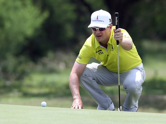 Zach Johnson lines up his birdie putt on the eighth green during the second round of the Texas Open golf tournament, Friday, April 21, 2017, in San Antonio, Texas. (Tom Reel/The San Antonio Express-News via AP)