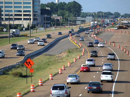 Motorists navigate a highway construction zone.