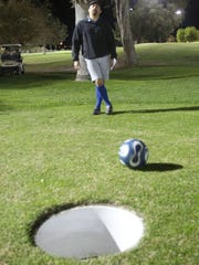 Alejandro Mejia laments a short kick during a game of footgolf at Indio Golf Course.