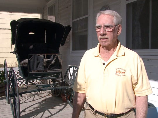 Bill Chambers, a vetrinarian, owns the largest horse and buggy carriage company on Mackinac Island.