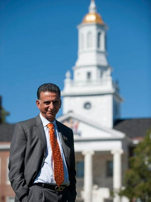 Rowan University President Ali A. Houshmand is seen on the campus green at Rowan University in Glassboro last year. Rowan broke ground Friday on a new building for the College of Business.