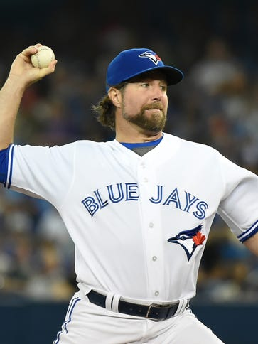 R.A. Dickey delivers a pitch at Rogers Centre.