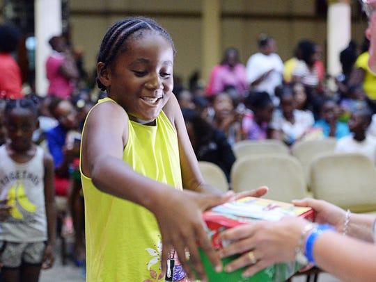 Eden Beazer, 9, receives an Operation Christmas Child
