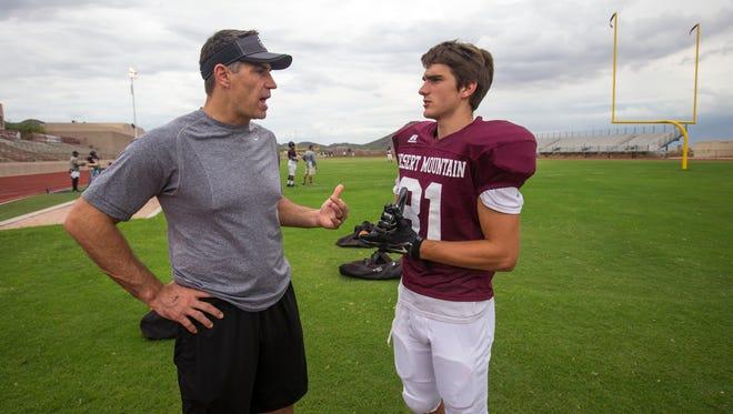 Former Cardinals quarterback Kurt Warner talks to his son, Kade, at a Desert Mountain high school football practice last season.