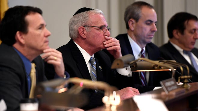 Assemblyman Declan O'Scanlon, R-Monmouth, left, and Assemblyman Gary Schaer, D-Passaic, listening to testimony Wednesday about Gov. Chris Christie's proposed state budget for the 2018 fiscal year.