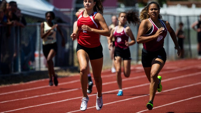 Moriah Oliveira, of Evangelical Christian School, competes in the 400m dash during the Class 1A District 8 track and field meet at St. John Neumann Catholic High School on Tuesday, April 17, 2018.