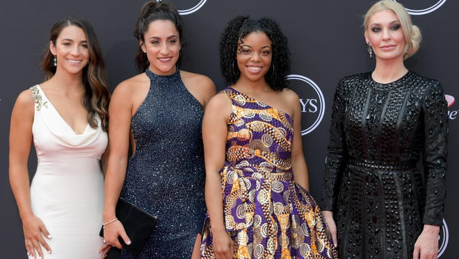 American gymnasts Aly Raisman, Jordyn Wieber, Tiffany Thomas Lopez and Sara Klein arrive for the 2018 ESPYS at Microsoft Theatre. Mandatory Credit: Kirby Lee-USA TODAY Sports