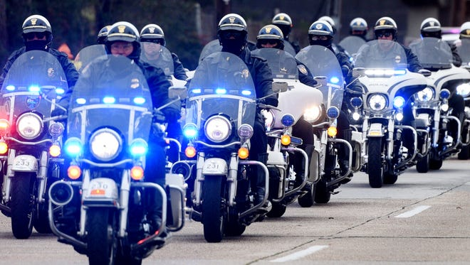 A procession of Shreveport police officers in January.