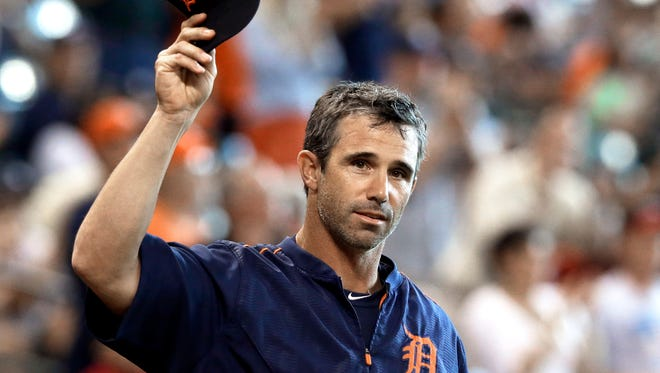 Tigers manager and former Astros catcher Brad Ausmus acknowledges the crowd as he is introduced for a celebration of the Astros' 2005 World Series team, before Saturday's game in Houston.