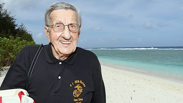 World War II veteran Frank Pontisso of Des Moines, 90, is shown on the landing beaches at Guam during his 2015 return trip to the region and the island of Iwo Jima where he fought 70 years ago.