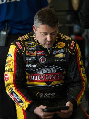 Tony Stewart, shown April 10, 2015 at Texas Motor Speedway, had surgery Wednesday to repair a burst fracture in his back.