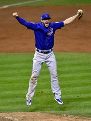 Chicago Cubs third baseman Kris Bryant celebrates after throwing to first for the final out of the World Series Wednesday.