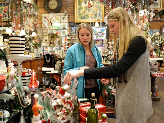 Halei Moody, right, and her sister Jackie Moody shop at Perennial Gardener on Tuesday, November 24, 2015.