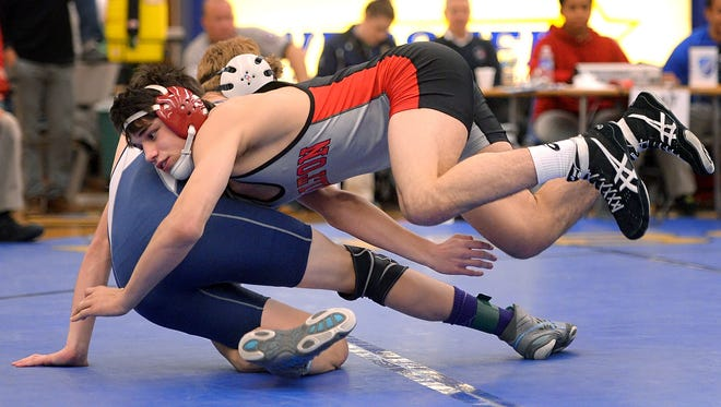 Hilton's Yianni Diakomihalis, front, pinned Gates-Chili's Derek St. James in the second period of the finals of the 138 pound weight class.