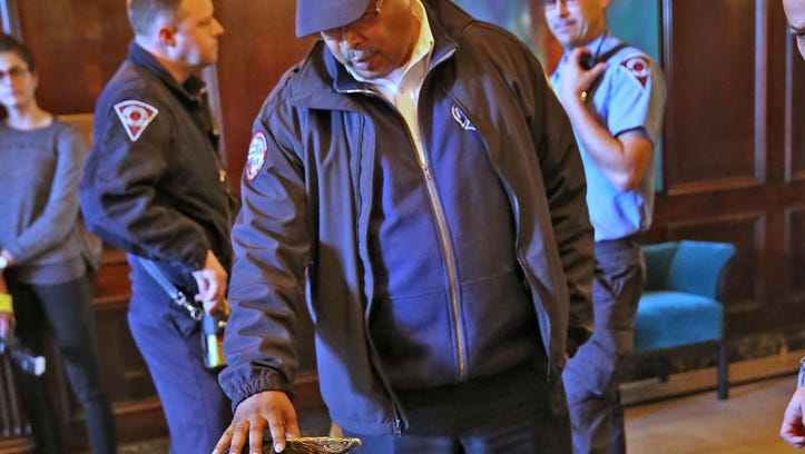 Doug Abernathy, Indianapolis Fire Department battalion chief of health and safety, touches a helmet displayed Feb. 2, 2016, at the Indianapolis Athletic Club condominium complex, 350 N. Meridian St., during a fundraiser. A group is raising $5,000 for a plaque to honor two firefighters who died in a Feb. 5, 1992, blaze there. After the deaths, the city updated its strategy for fires in high-rises.