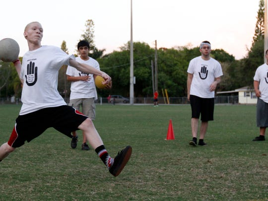 Myrie Robinson, Ivan McDaniel, Julio Simonelli and Rosendo Nucamendi play dodgeball Wednesday, March 4 at Schandler Community Park in Fort Myers.