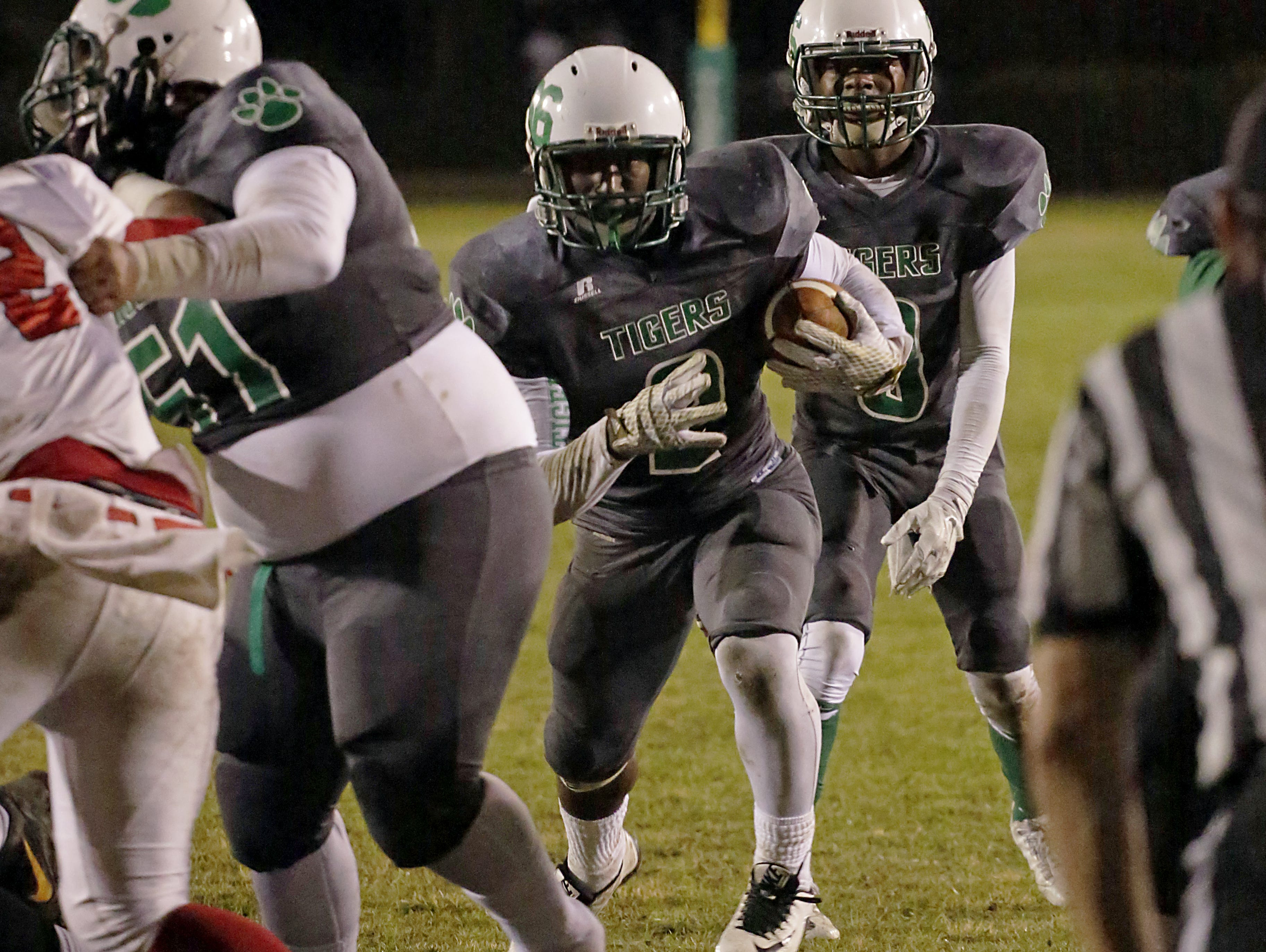 Collins player Timothy Durr (2) runs the ball during the 3A South State Championship game against West Marion last week.