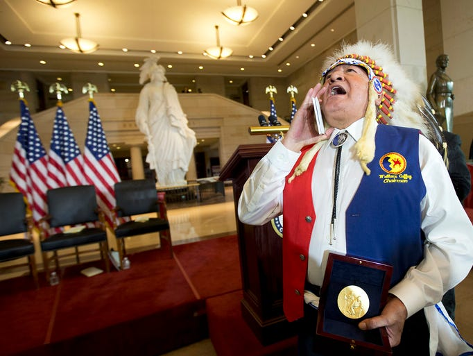 Wallace Coffey, chief of the Comanche Nation of Oklahoma, chants as he holds his tribe's Congressional Gold Medal during a ceremony Nov. 20 on Capitol Hill in Washington. Twenty-five Native American tribes received the medal in recognition of their dedication and valor as code talkers during World War I and II. The military used tribal languages as a means of secret communication during both wars.