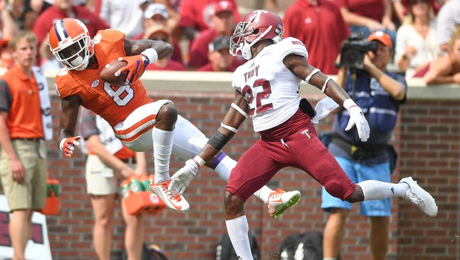Clemson wide receiver Deon Cain (8) catches a touchdown past Troy cornerback Jalen Rountree (22) during the 4th quarter Saturday at Clemson's Memorial Stadium.