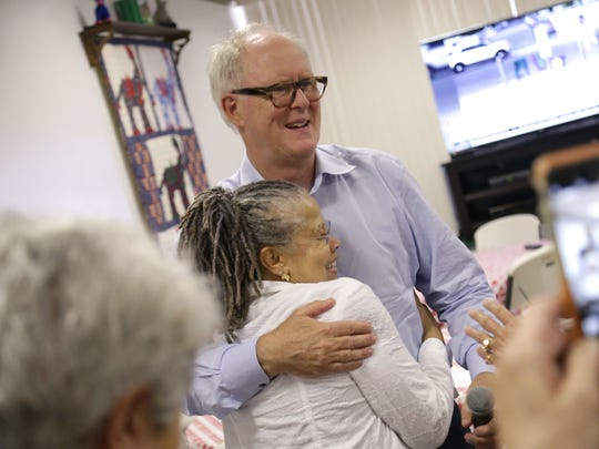 Actor John Lithgow hugs Lillie Shelby at the Richland County Democratic Party headquarters on Saturday. Lithgow was campaigning for Hillary Clinton.