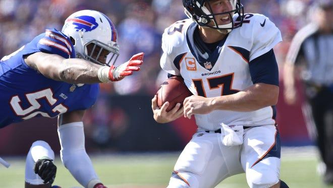 Denver Broncos quarterback Trevor Siemian is sacked by Buffalo Bills middle linebacker Preston Brown during Sunday's game.