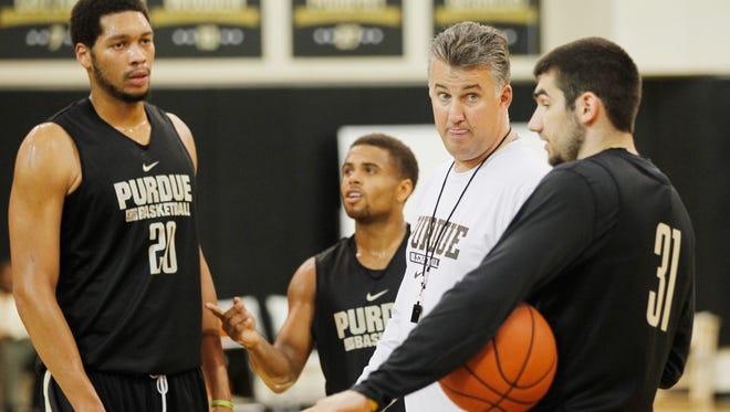 Head coach Matt Painter takes a question form Dakota Mathias during men's basketball practice Monday, October 5, 2015, at Cardinal Court on the campus of Purdue University.