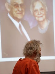 Jeffrey Maurer, 54, was convicted of first-degree premeditated murder in the deaths of his parents William Maurer, 87, and his wife, Gayle Maurer, 85, projected in the courtroom behind him.