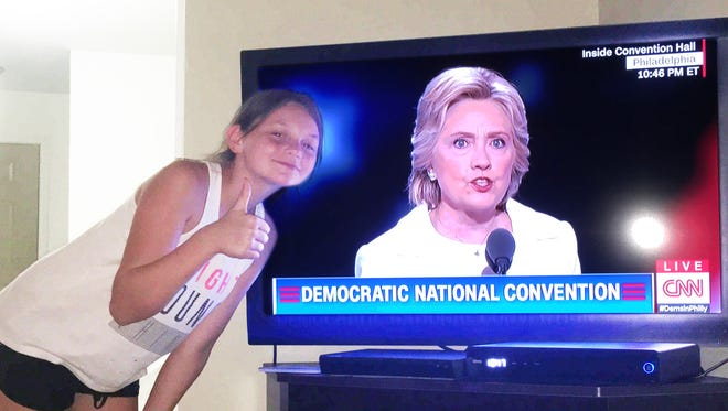 Amaya Johnson, 12, of Lansing gives her approval to Hillary Clinton during the candidate's acceptance of her nomination as the Democratic Party candidate for president -- the first female to run for the office in a major political party.