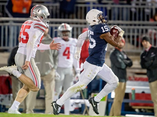 In this Oct. 22, 2016, file photo, Penn State's Grant Haley returns a blocked field goal for a touchdown against Ohio State in an NCAA college football game, in State College, Pa. The blocked field goal in the fourth quarter against Ohio State changed Penn State's season. (Abby Drey/Centre Daily Times via AP, File)