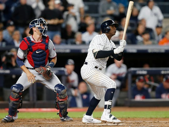 Minnesota Twins catcher Jason Castro and New York Yankees' Didi Gregorius watch Gregorius' first-inning, three-run home run in the American League wild-card playoff baseball game in New York, Tuesday, Oct. 3, 2017.