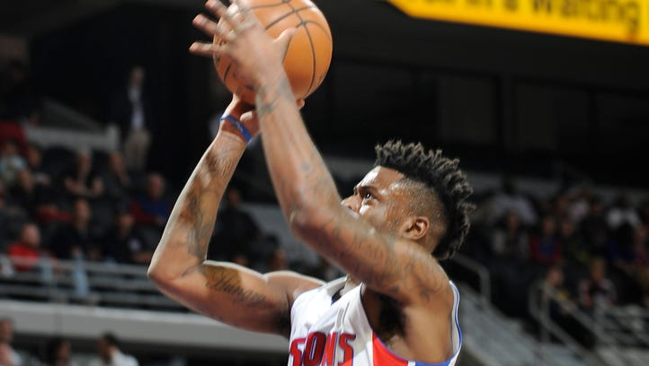 Pistons' Reggie Bullock shoots over the Hawks' Dennis Schroder in the first quarter. Bullock had 15 points and six rebounds.