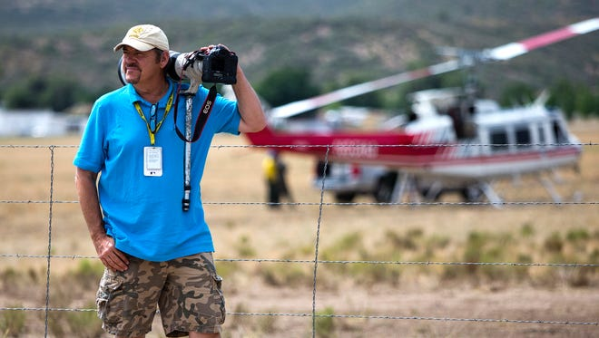 Arizona Republic photographer Tom Tingle waits for a shot during coverage of the Yarnell Hill Fire.