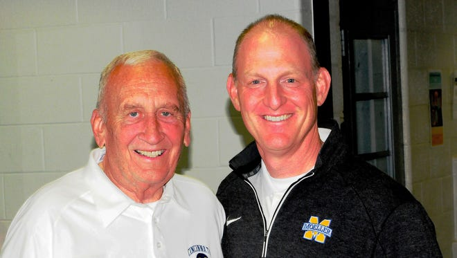 Moeller athletic director Mike Asbeck, right, greets famed Crusader football coach Gerry Faust upon his arrival to the Moeller campus.