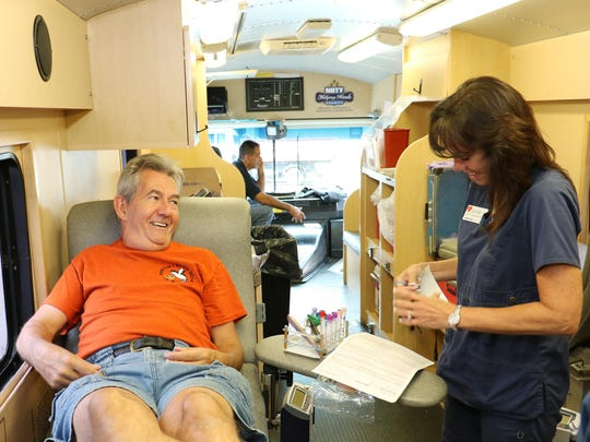 Jim Keane, of Poughkeepsie, jokes with Donation Specialist Jeanne Ritter before donating blood on the New York Blood Center donation bus located at the Poughkeepsie Journal Building on Tuesday.