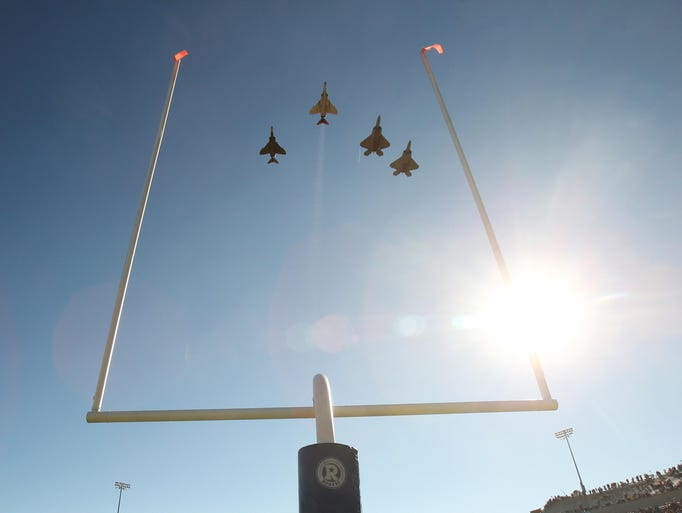 F-22s and F-18s before the game between the Air Force