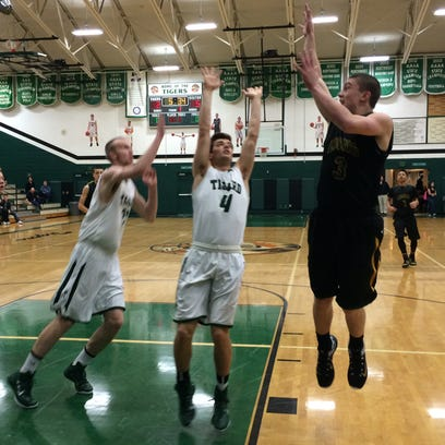 West Linn's Payton Pritchard puts up a floater in the