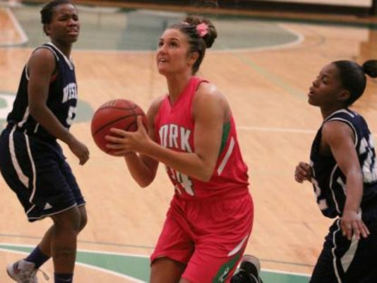 In this photo from ycpspartans.com, Brittany Hicks is shown going to the basket against Wesley College.