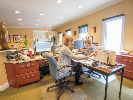 Sharon Esposito, left, and office manager Jane Carroll