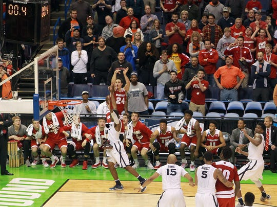 Wisconsin's Bronson Koenig drills the winning shot against Xavier.