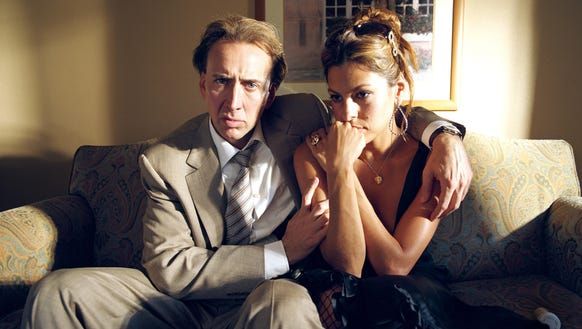 Nicolas Cage (left, with Eva Mendes) is a cop with