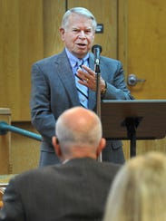 Retired judge, Tom Bacus, spoke during a memorial recognizing