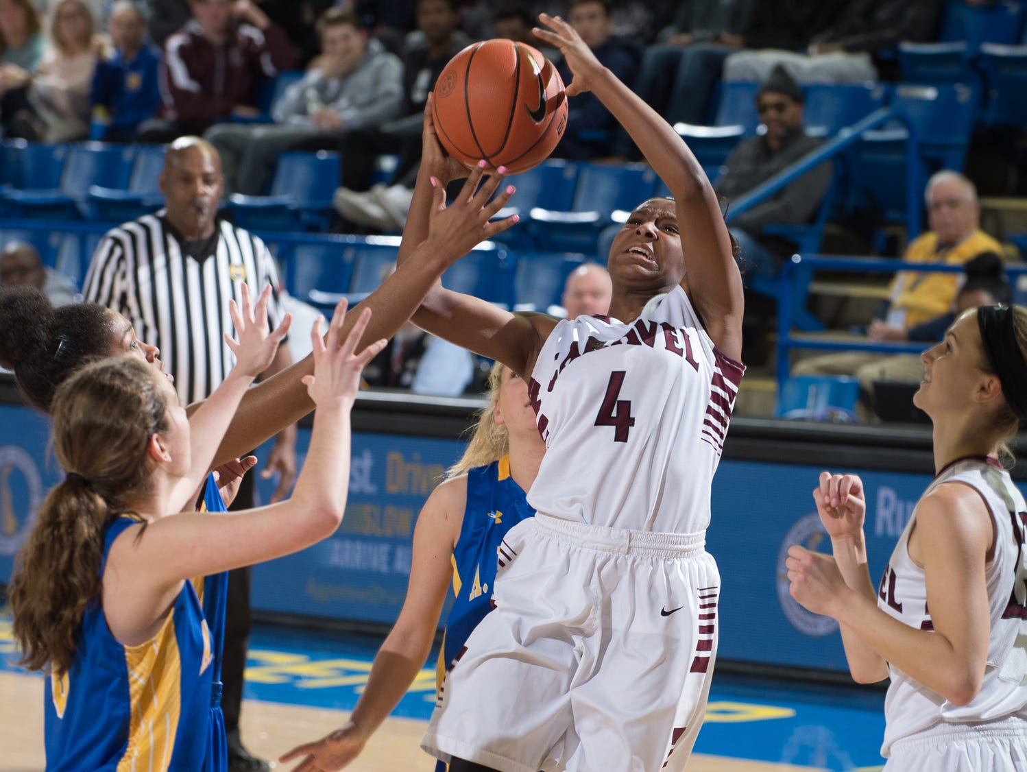 Caravel's Sasha Marvel (4) goes up for a shot in the quarterfinals of DIAA Girls Basketball Tournament at the University of Delaware against A.I. duPont.
