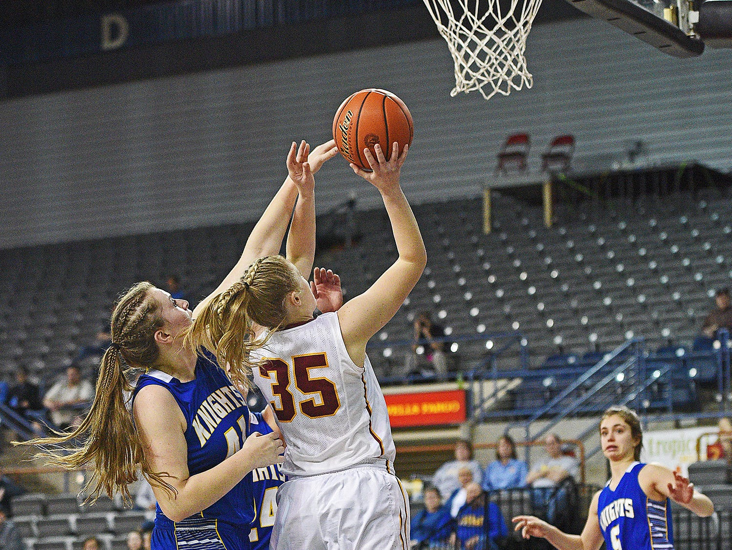 Roosevelt's Madisyn Waltman (35) goes up for a shot as O'Gorman's Courtney Baruth (41) defends during a 2017 SDHSAA Class AA State Girls Basketball quarterfinal game Thursday, March 16, 2017, at Rushmore Plaza Civic Center in Rapid City. O'Gorman beat Roosevelt 37-33.