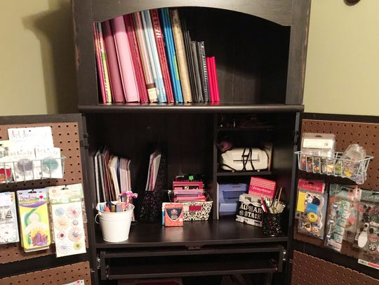 Molly Schenk turned an TV/computer armoire into a scrapbooking station with shelves and baskets for her supplies.
