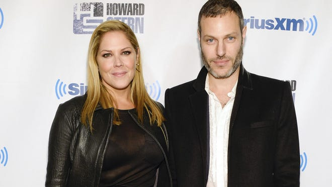 """In this Jan. 31, 2014 file photo, actress Mary McCormack, left, and husband Michael Morris attend """"Howard Stern's Birthday Bash"""" in New York. McCormack has shared video of her husband's Tesla car shooting flames while in Southern California traffic. McCormack said in an accompanying tweet Friday, June 15, 2018, that there was """"no accident"""" and the incident was """"out of the blue."""""""