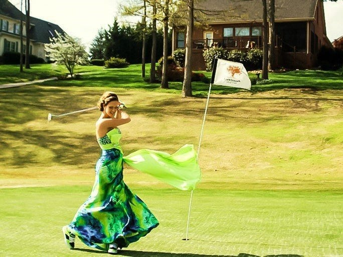 Chelsea Passmore said this is her favorite prom photo. It was taken at Avalon Golf Course before she went to Farrgut High School's prom. 'I have played golf for most of my life so it seemed normal to take a picture on the golf course,' said Passmore in an email. 'I didn't plan on swinging a full club in my dress so I only brought my putter to take pictures with. The wind was crazy and as you can see, was blowing my dress around so I was goofing off when the photographer caught this shot.'