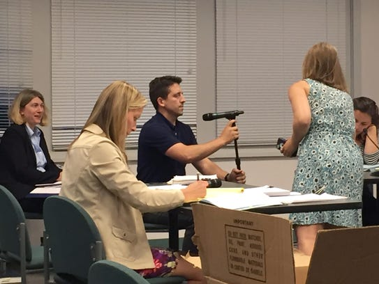 Town Manager Joe Colangelo adjusts a microphone ahead