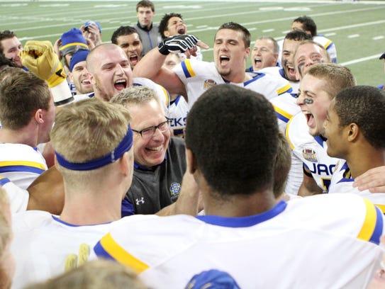 South Dakota State Head Coach John Stiegelmeier (middle)