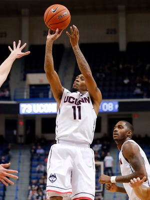 Ryan Boatright (11) had a team-high 17 points as the UConn Huskies won big over Maine.