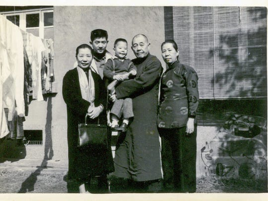 In this 1963 photo, young Kyle Chen poses with his two grandmothers, uncle Mark and grandfather Ta-Chun Chien.